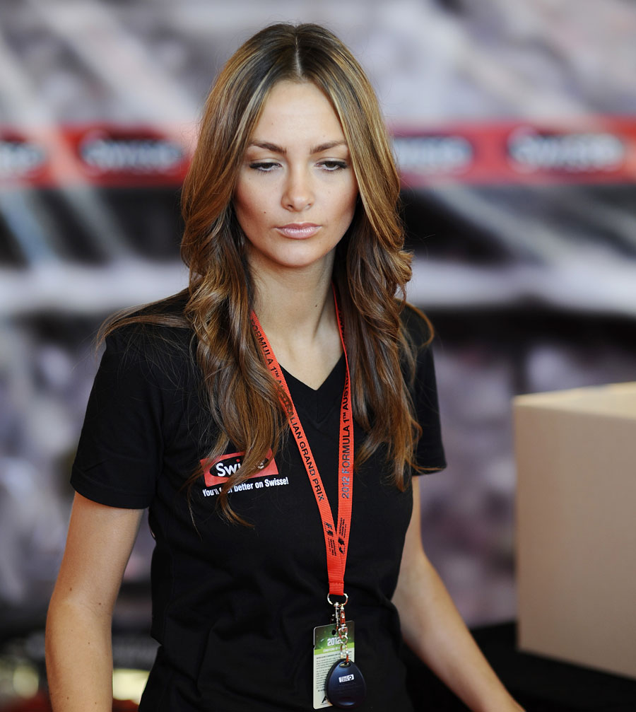 A promotional girl watches over a slot car race