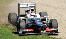 Kamui Kobayashi recovers his Sauber from the turn one gravel trap