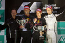 Christian Horner, Mark Webber and Sebastian Vettel celebrate Red Bull's first ever 1-2 on the podium with Jenson Button
