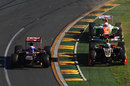 Daniel Ricciardo, minus a front wing on his Toro Rosso, gets passed by Kimi Raikkonen and Paul di Resta on the grass
