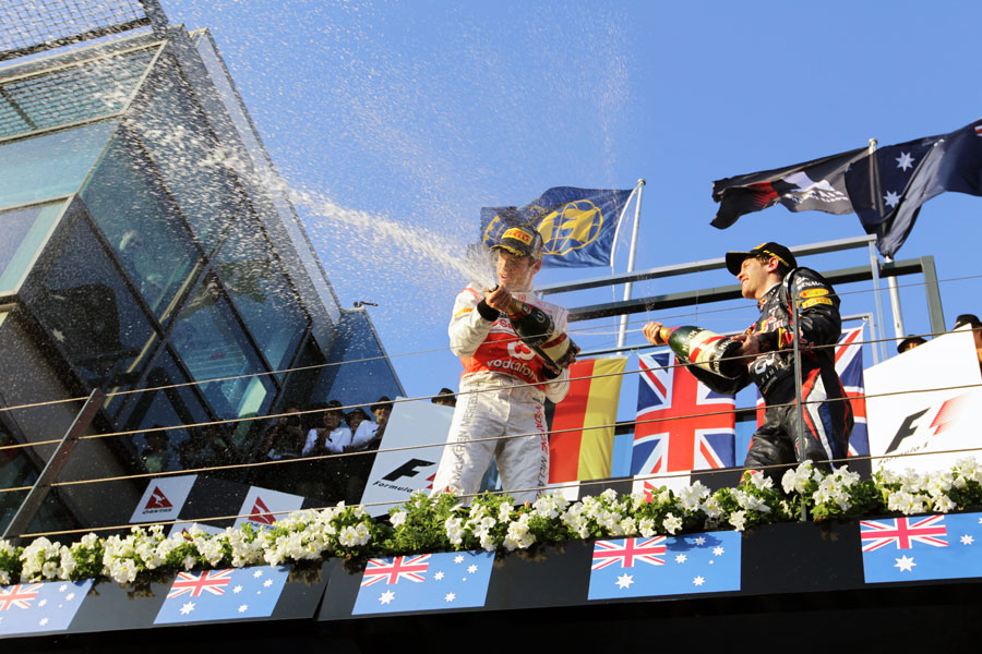 Jenson Button and Sebastian Vettel celebrate on the podium