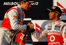 Lewis Hamilton congratulates Jenson Button on winning the first race of the season