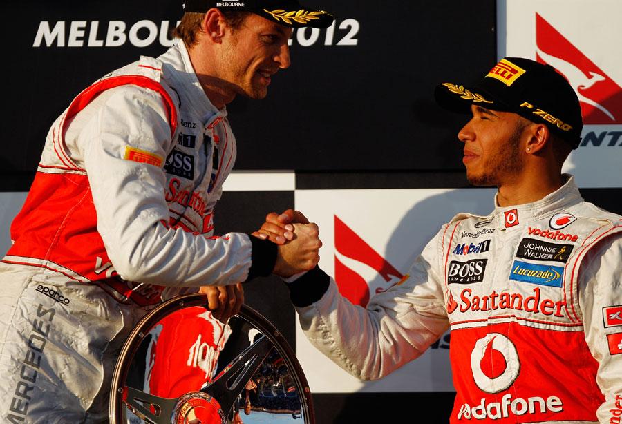 Lewis Hamilton congratulates Jenson Button on winning the first race of the season