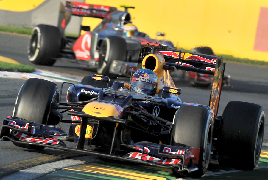 Sebastian Vettel leads Lewis Hamilton in the closing stages