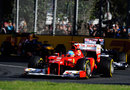 Fernando Alonso leads Pastor Maldonado and Mark Webber early in the race