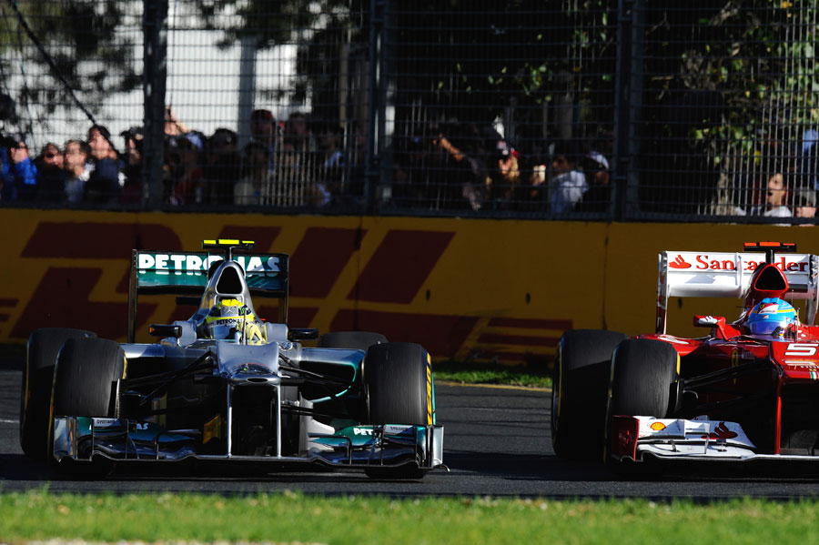 Nico Rosberg holds off Fernando Alonso in to turn three