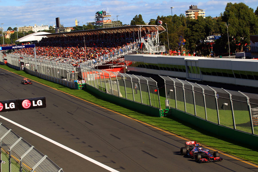Jenson Button leads from Lewis Hamilton as he starts another lap