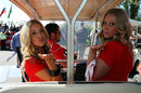 Grid girls catch a lift to the paddock