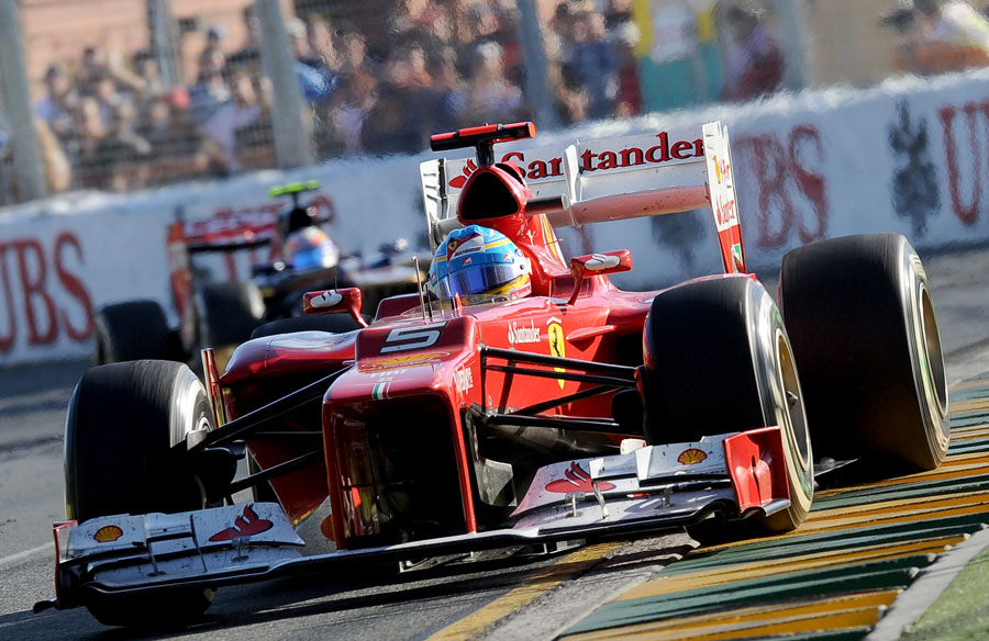 Fernando Alonso exits the final corner