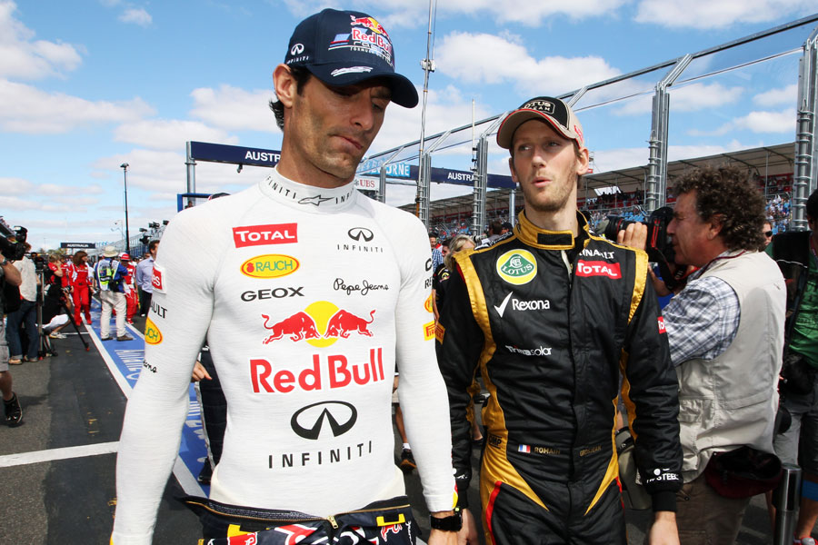 Mark Webber chats to Romain Grosjean ahead of the race