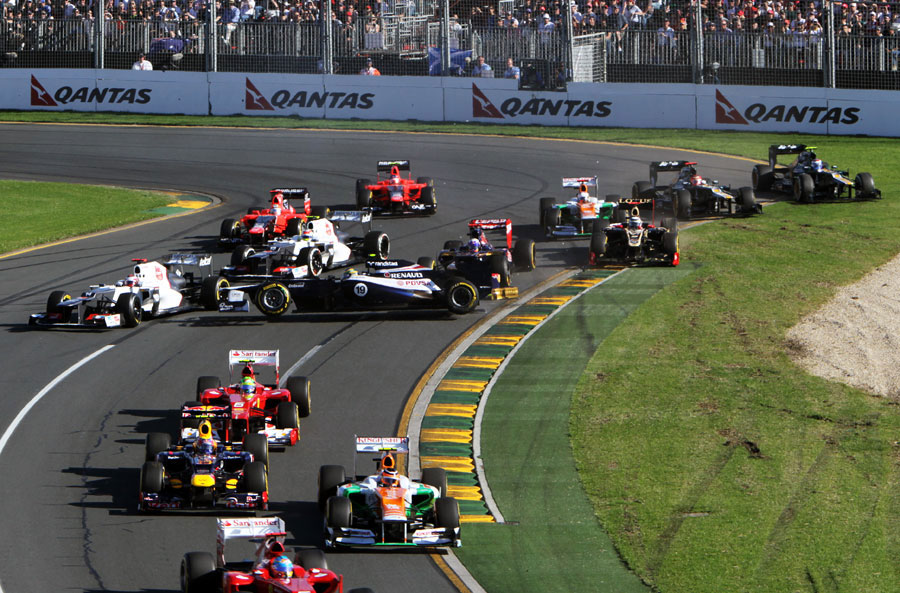 Bruno Senna and Daniel Ricciardo make contact at the start of the race