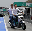 Michael Schumacher takes Mercedes third driver Sam Bird out for a lap of the circuit