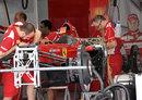 Ferrari mechanics work on Felipe Massa's new chassis