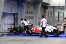 Sam Michael with McLaren engineers taking the MP4-27 to scrutineering