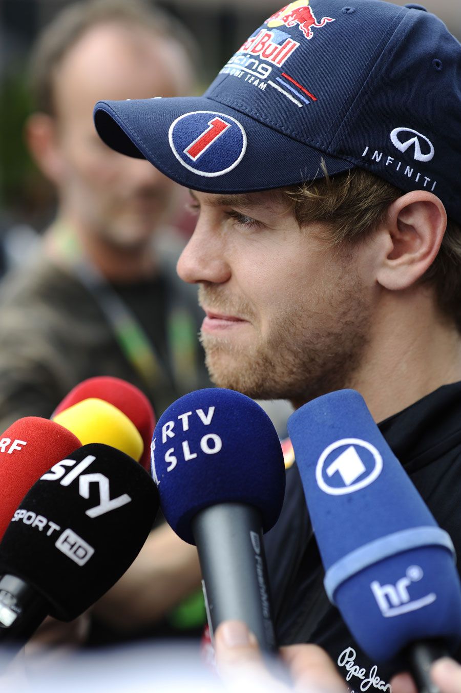 Sebastian Vettel speaks to the media in the paddock