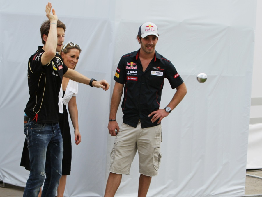 French drivers Romain Grosjean and Jean-Eric Vergne play boules in the paddock