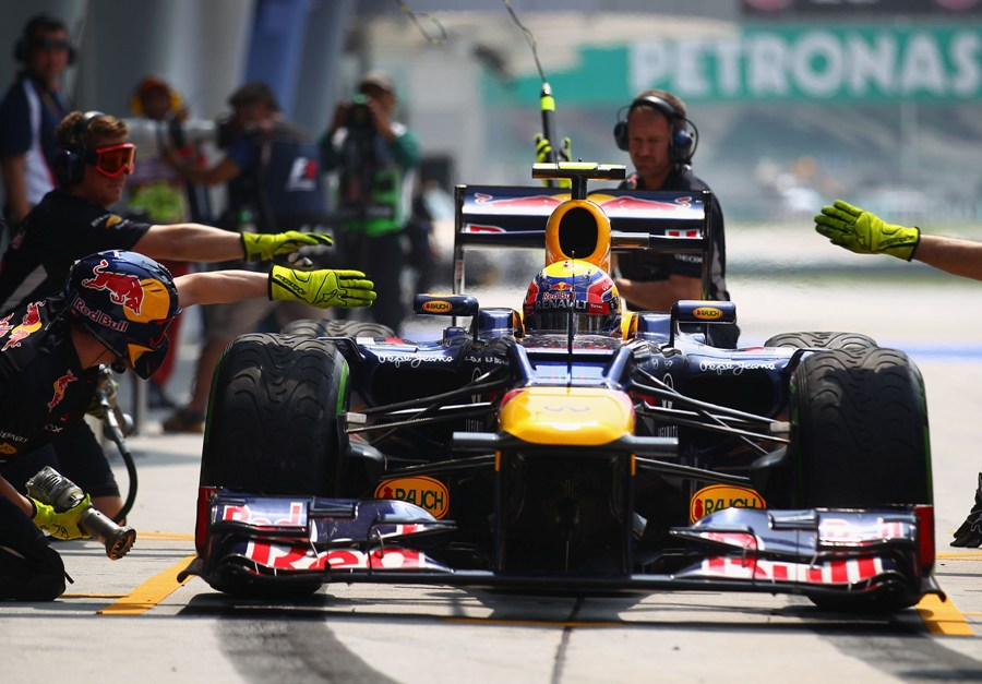 Mark Webber takes on intermediate tyres during a practice pit stop