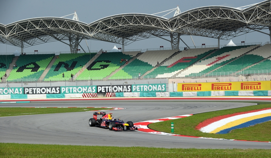 Sebastian Vettel tackles turn two