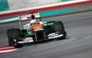 Paul di Resta attacks the circuit in his Force India