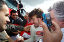 Fernando Alonso gets swamped by media and fans