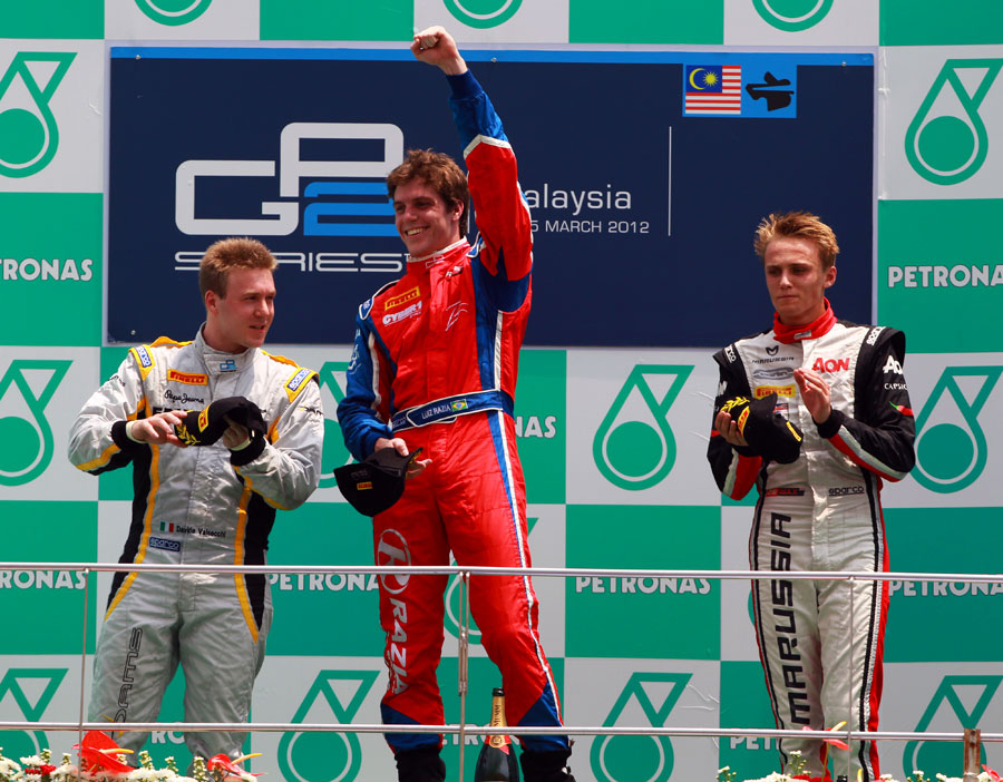 Luiz Razia celebrates on the podium between Davide Valsecchi and Max Chilton