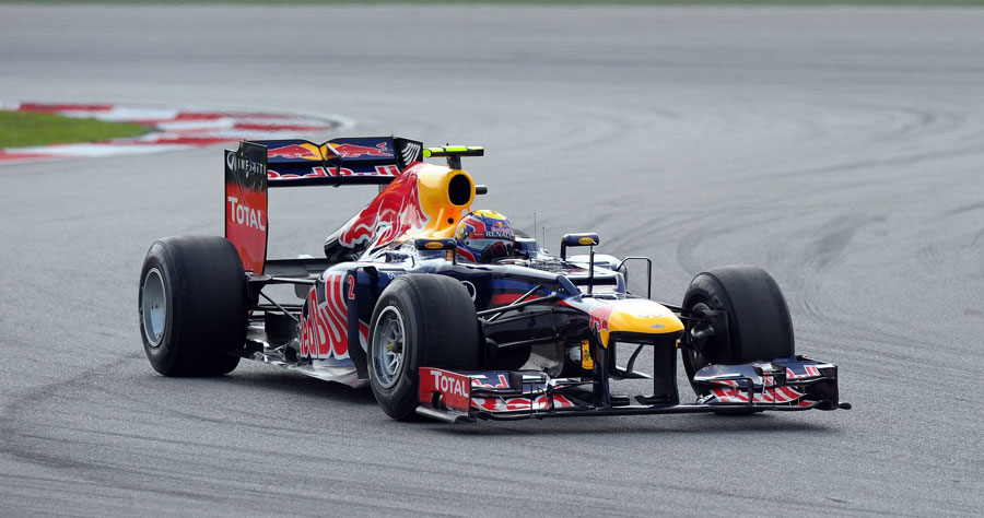 Mark Webber negotiates turns one and two