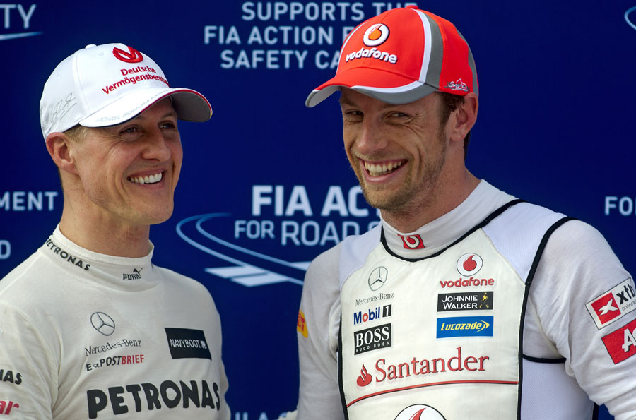 Jenson Button and Michael Schumacher joke in parc ferme
