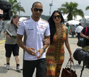 Pole-sitter Lewis Hamilton arrives at the circuit with his girlfriend Nicole Scherzinger