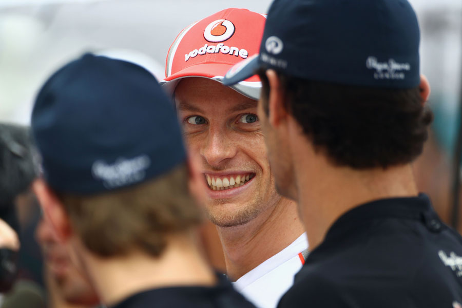 Jenson Button shares a joke with the Red Bull drivers