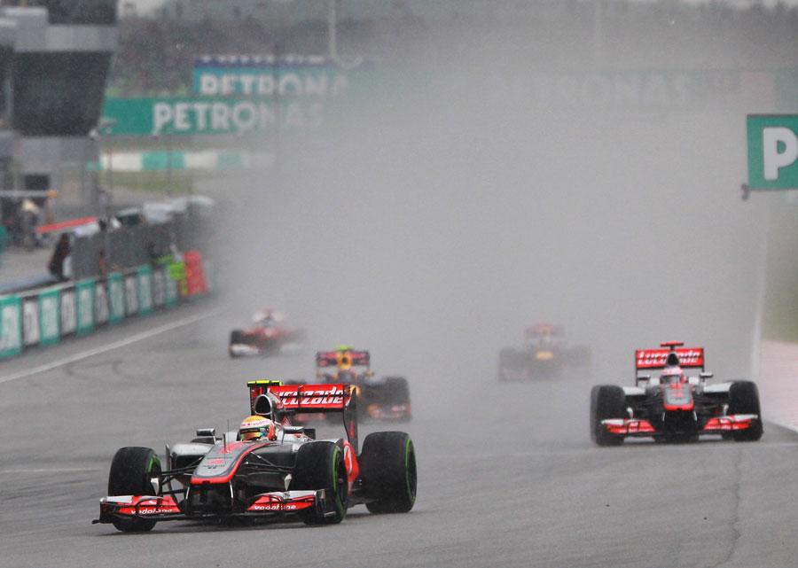 Lewis Hamilton leads Jenson Button as the rain intensifies