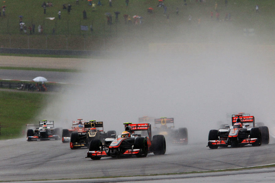 A wall of spray greets the field as it approaches turn four