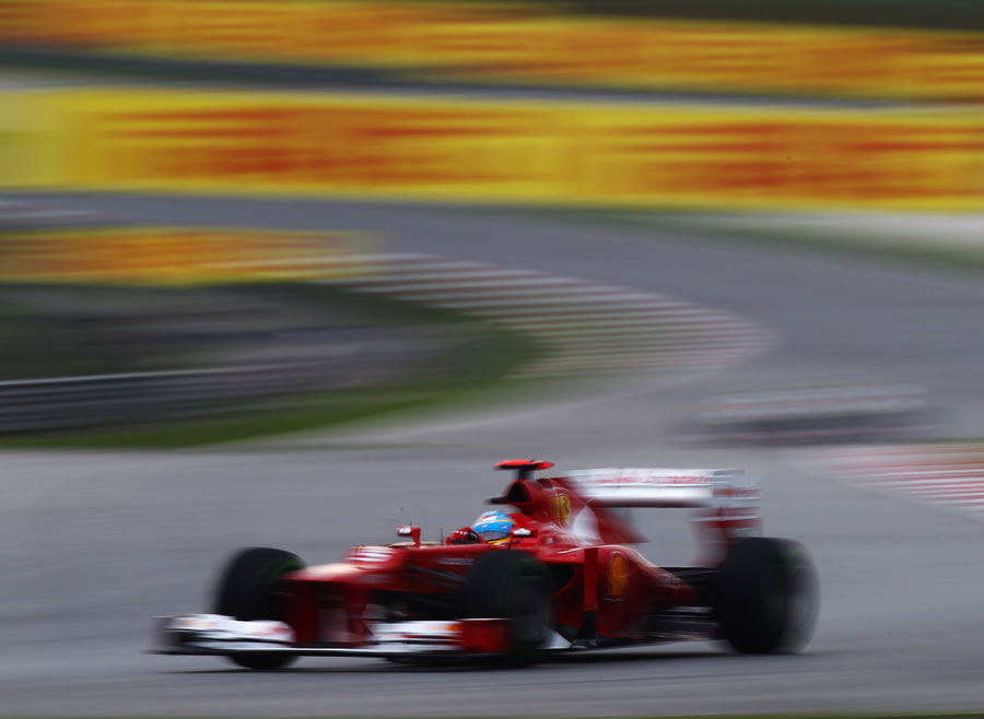 Fernando Alonso leads as the track dries out