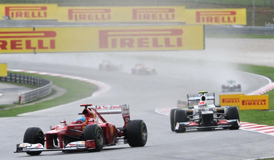 Fernando Alonso leads Sergio Perez