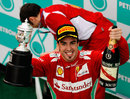 Fernando Alonso celebrates his first victory of the season on the podium