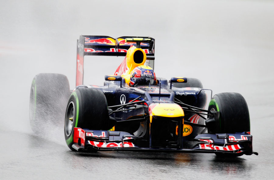 Mark Webber looks for grip on the intermediate tyres