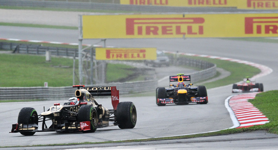 Kimi Raikkonen leads Mark Webber in to turn four