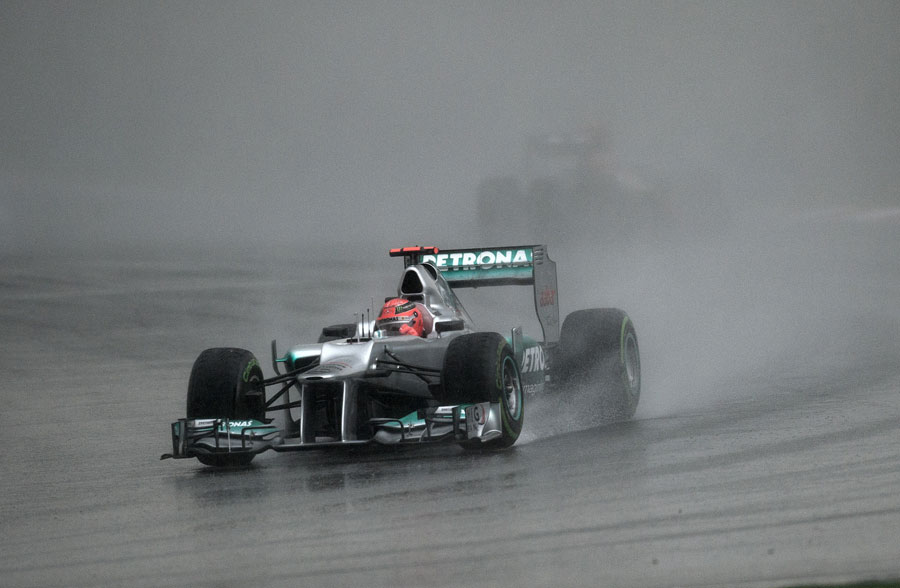 Michael Schumacher recovers after an early spin