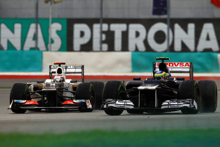 Bruno Senna puts a move on Kamui Kobayashi