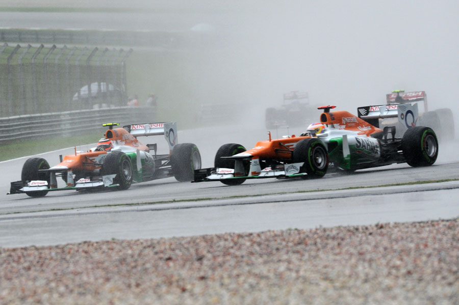 Paul di Resta and Nico Hulkenberg battle in the rain