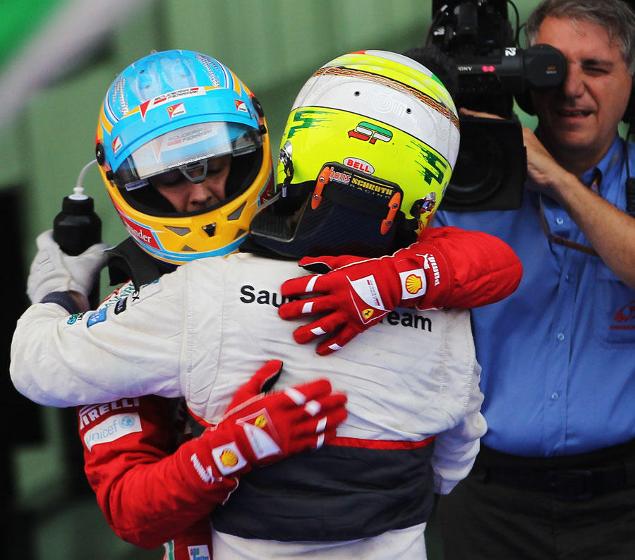 Fernando Alonso and Sergio Perez congratulate each other in parc ferme