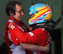 Stefano Domenicali congratulates Fernando Alonso after the race