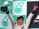 Sergio Perez celebrates on the podium