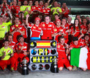 Fernando Alonso celebrates victory with his Ferrari team, Malaysian Grand Prix, Sepang, March 25, 2012