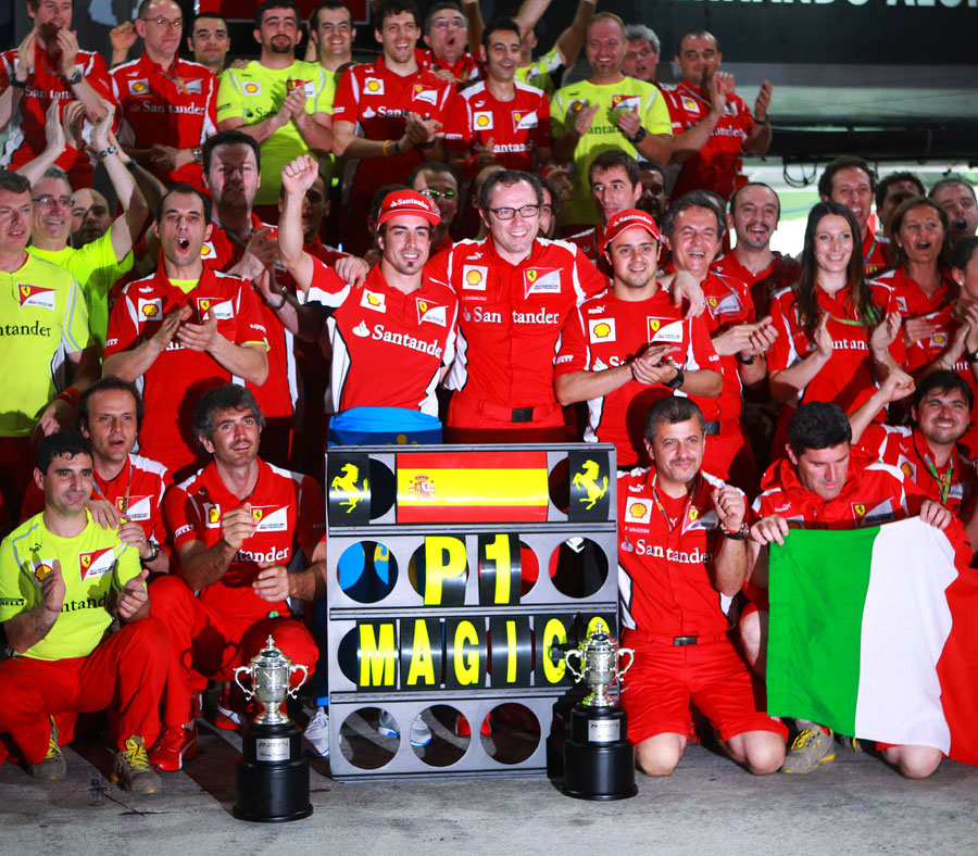 Fernando Alonso celebrates victory with his Ferrari team