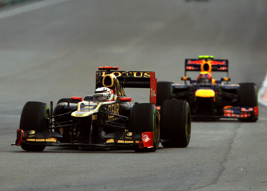 Kimi Raikkonen leads Mark Webber on a drying track