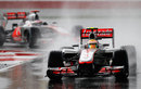 Lewis Hamilton leads Jenson Button during the worst of the conditions, Malaysian Grand Prix, Sepang, March 25, 2012