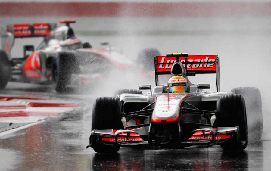 Lewis Hamilton leads Jenson Button during the worst of the conditions