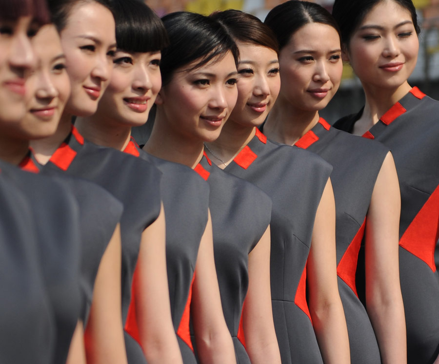 Chinese models pose during a launch show for the 2012 Chinese Grand Prix