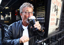 Eddie Jordan celebrates his honorary OBE with a drink at the Toucan Bar