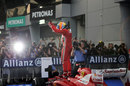 Fernando Alonso celebrates his first victory of the season on top of his car